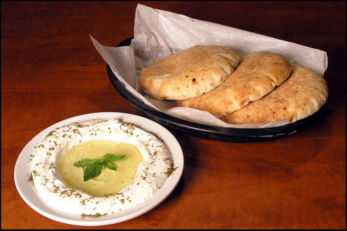 Labni Cheese Creamy cheese served with olive oil, mint, za'atar and fresh hot pita bread
