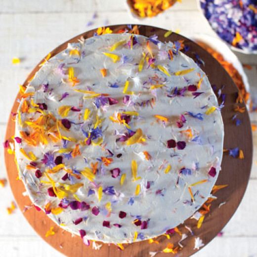 Even mixed petals from edible flowers sprinkled over a thin layer of cream cheese would make for a colourful and interesting-looking cake.
