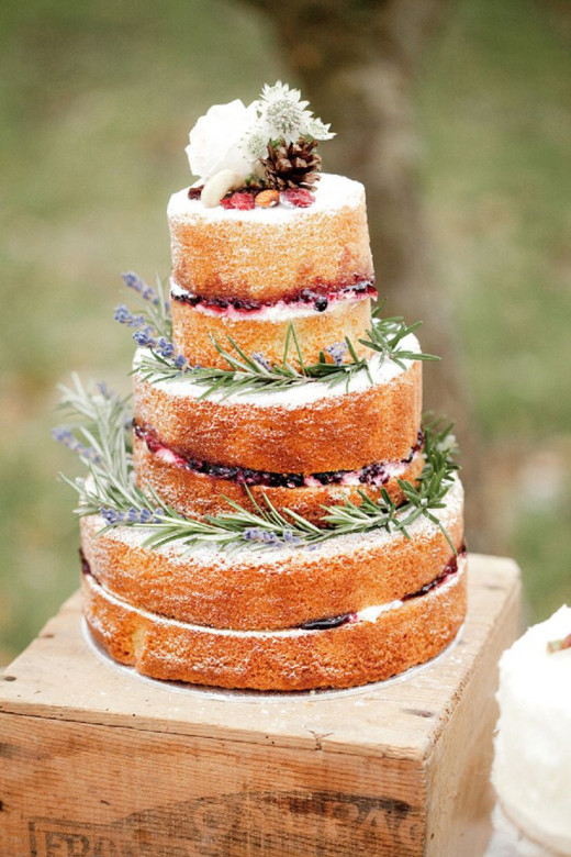 This beautiful naked wedding cake could be made with unsweetened whipped cream and stewed fruit between the layers and these same lovely herb and flower decorations.