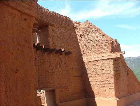 A side of wall of the mission ruins shows modern attempts to secure, yet return the original structure to some authenticity.