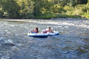 Many tubers and rafters drift down the river on warm days.