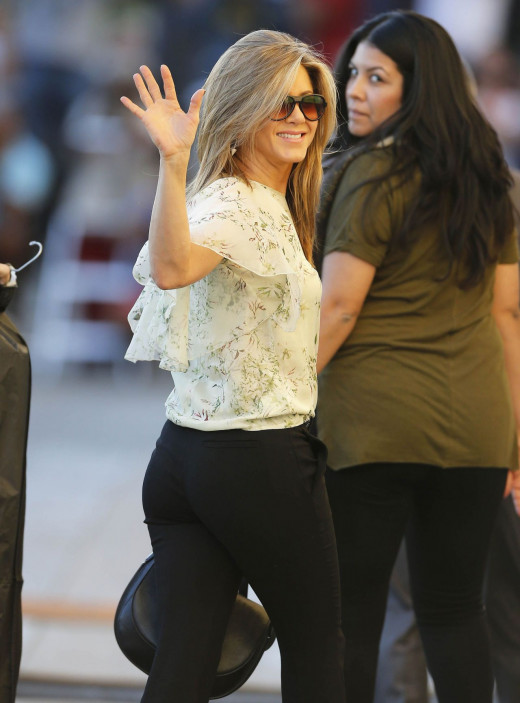 Jennifer Aniston booty in black trousers arriving at Jimmy Kimmel show