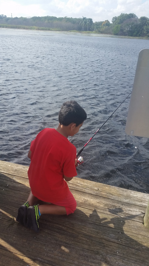 Teaching a child how to caught a fish