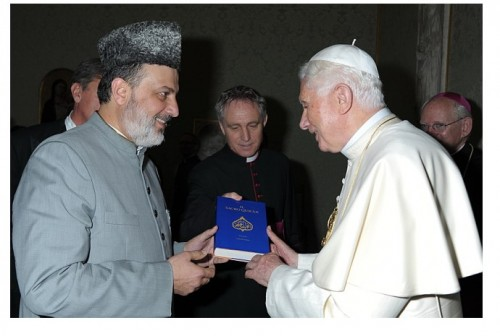 The chief of The Ahmadiyya community in Middle East, Dr. Sherif Odeh, presents a copy of The Holy Quran to Pope Benedict XVi. The Quran is the only scripture to hold the legend that it is the spoken word of God in its entirety