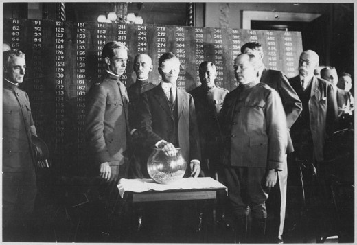 Blindfolded Secretary of War Newton D. Baker Drawing first draft number on July 20 1917