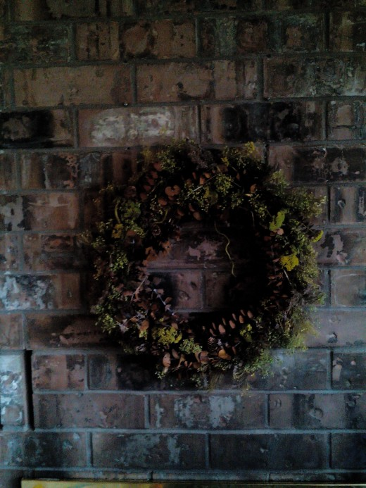 My first wreath. I started with a bouquet of grasses from Hobby Lobby, which included a variety of plant materials in the same color family. This piece has required little in forms of glue and twine in order to hold form.
