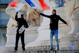 The French flag flies in the Place de la République on Sunday 11th January 2015