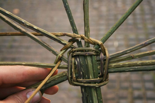 Star Structure/ Foundation Piece in First Stages of Weaving. In this piece user has chose to braided pieces as the weaving medium throughout the structure. Continue to bend structure upwards to create a bowl shaped effect.
