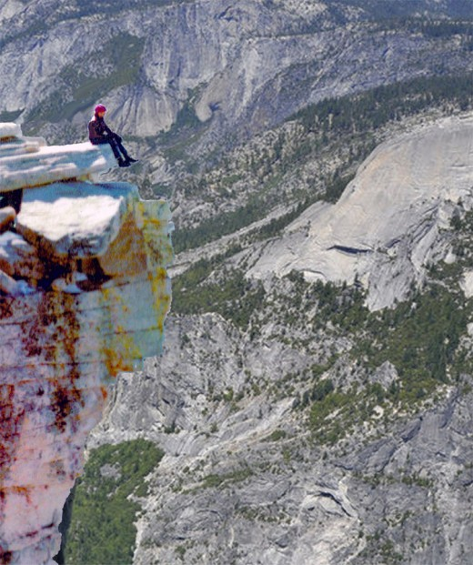 Ronald A Newcomb sitting on Half Dome's bill, Yosemite. We were the only ones there!