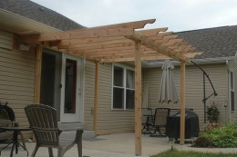 Here is an example of an attached patio cover.  Photo by http://www.flickr.com/photos/jshappell/615312439/
