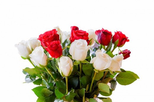 A bouquet of white and red roses symbolizing innocence, purity, and love.
