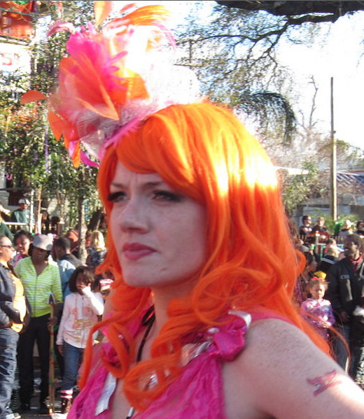 Girl wearing orange wig at New Orleans Mardi Gras. (This is a cropped/edited version of the photo. To see the original, click on the link.)