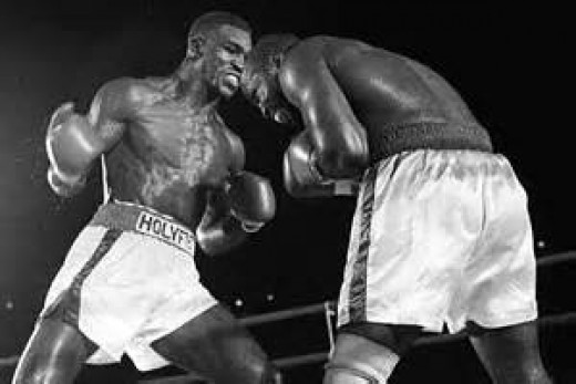 Dwight Muhammad Qawi was a champion as a light heavyweight and as a cruiserweight. In this photo he is fighting Evander Holyfield.