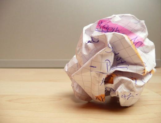 Cliche crumpling of the paper when ideas are gone.