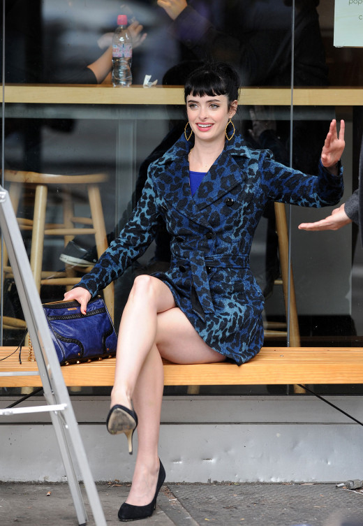 Krysten Ritter crossed legs on set