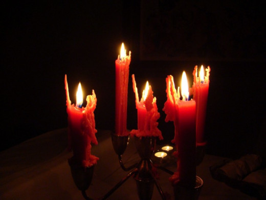 Spooky halloween candles in dark