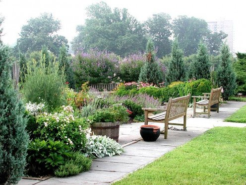 I would love to sit on that bench in that herb garden.  It is so beautiful!