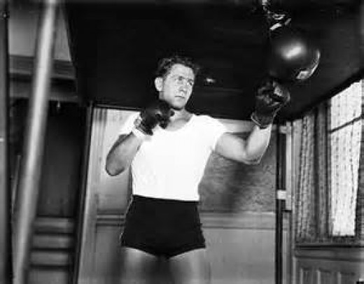 Former Light Heavyweight champion Gus Lesnevich is seen here working out on the speed bag.