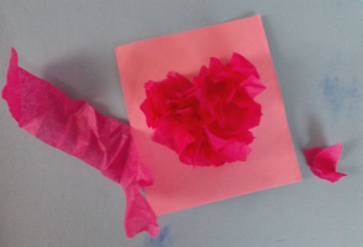 Tissue paper makes the card pop out of the typical flat shape.