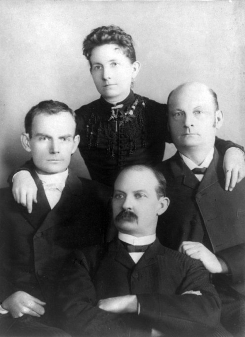 Sitting left-to-right: Bob, Jim and Cole Younger, with their sister Henrietta