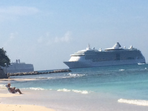 Some cruise ships are close enough to see from the beginning of Seven Mile Beach, but the Disney Magic is too far at this point to spot.