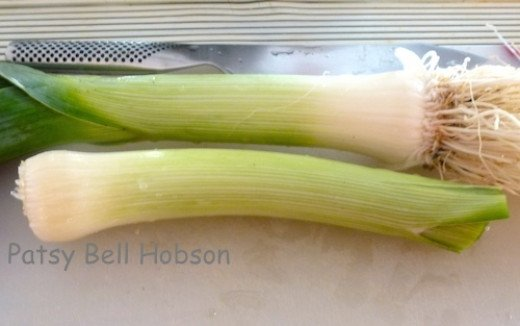 Blanche leeks by covering the base with soil, the reason leeks are so gritty or sandy. This is an optional practice.