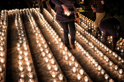 People lay candles at a memorial in Lyon, France.