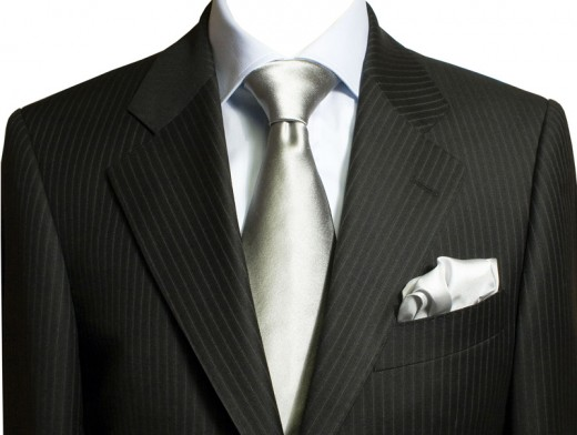 Pinstripe suit and silver necktie