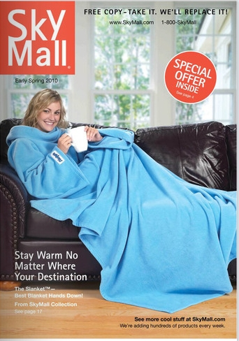 SkyMall magazine cover feature a women wearing a blue snuggie