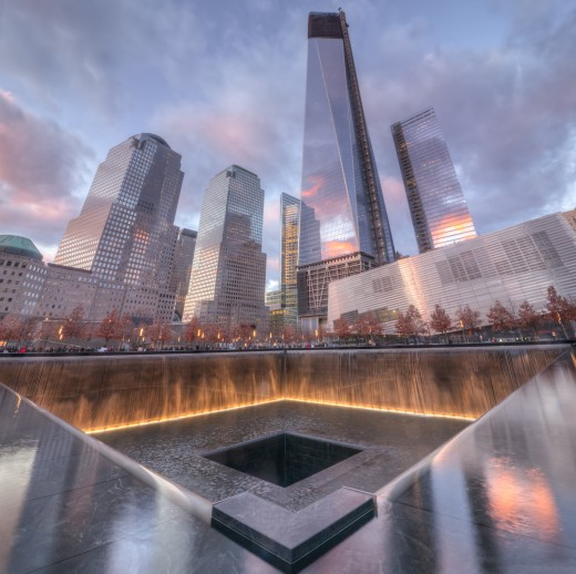 The new Trade Tower hovering above the 9/11 Memorial,