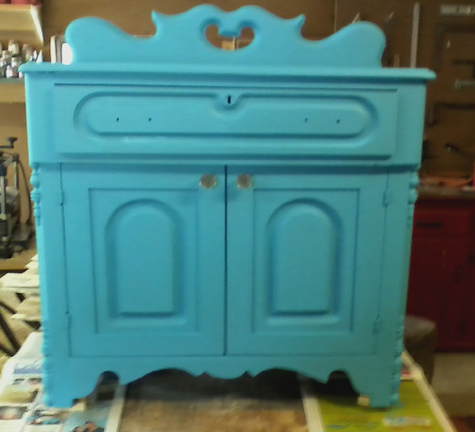 After two coats of chalk paint the cabinet is ready for some light distressing.