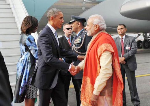 Obama greeted by Modi on arrival at Delhi airport