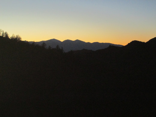 Sunset with the outline of the mountains.