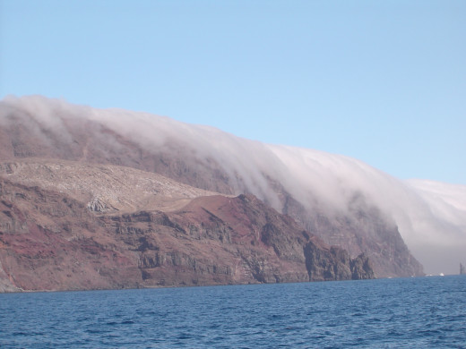 Fog rolling over the jagged cliffs of Guadelupe Island