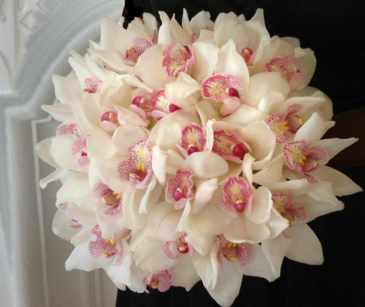 Silk bridal bouquets like this Orchid bouquet can look so realistic you can't tell the difference.