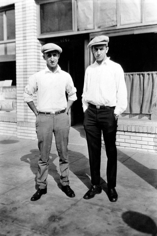 Roy (left) and Walt (right) pose for a picture after a morning of delivering newspapers.