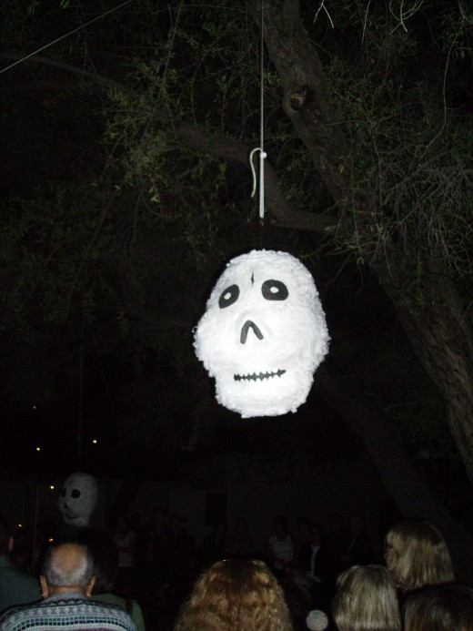 Ghostly Piñata on patio as a treat for the children.
