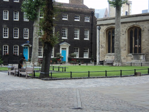 Tower Green in the Tower of London, where Anne Boleyn was executed.  Her remains are buried in the altar of St Pater ad Vincula in the background.