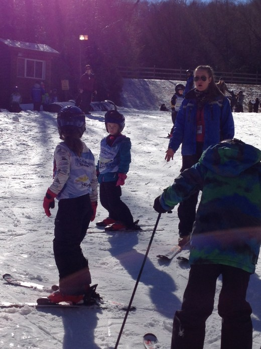 Rea (in the middle with the vest on) during her class ski lesson. She was awesome!