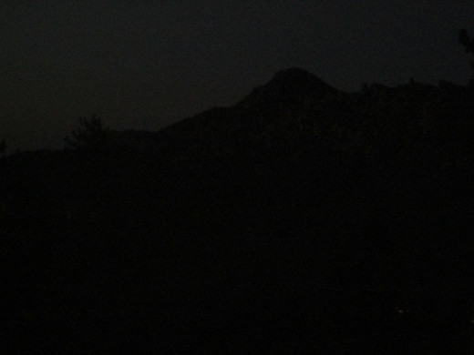 Another photograph of the outline of the Pinnacles before the darkness of night.