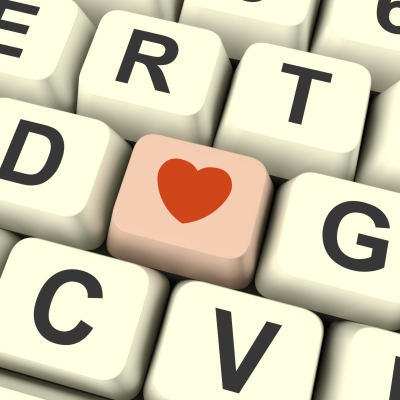 """""""Pink Heart Sign Computer Key"""" and """"Girl Showing Online Dating Board"""" by Stuart Miles Source:  http://www.freedigitalphotos.net/"""
