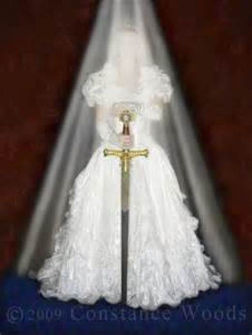 The bride is holding her sword! Which translates into the Word of God covering her life.