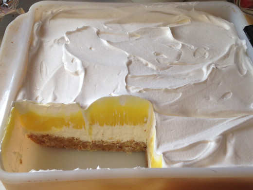 Lemon dessert with cream cheese, lemon pudding, and Cool Whip layers