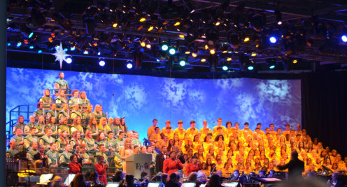 Celebrity Jodi Benson narrates The Christmas Story supported by a mass choir and a 50 piece orchestra during the Candlelight Processional at Walt Disney World's EPCOT