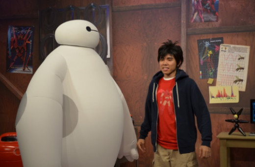 Baymax and Hiro from Disney's BIG HERO 6 entertain guests during a meet and greet at Disney's Hollywood Studios during Thanksgiving Week.in the Walt Disney Animation Courtyard area of the theme park.