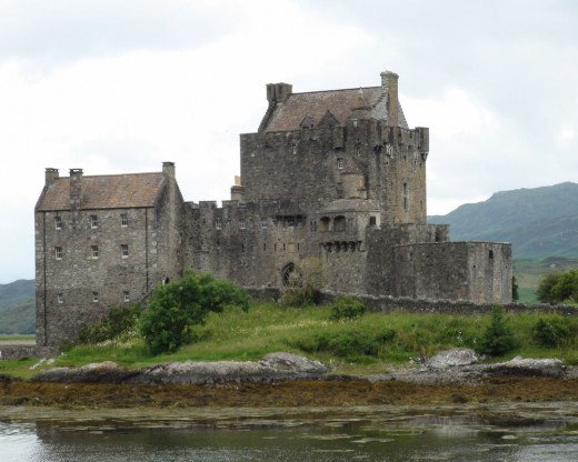 Eilean Donan is a castle that is located on a small island.  It was built here in a very strategic military location.  Access to this castle is from either boat or the main bridge.