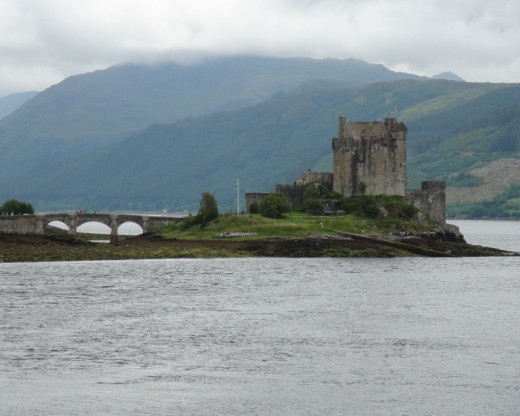 "Eilean Donan - photograph taken from the roadway.  This view shows the main bridge, which is used in the opening scenes from the motion picture ""Highlander""."