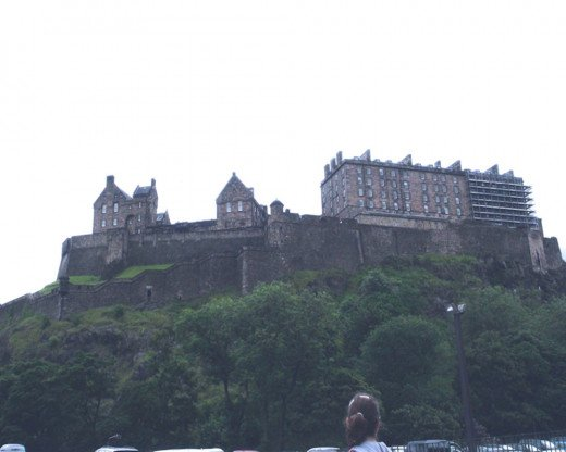 Edinburgh Castle is located on the top of Castlehill.  This photo was taken on a rainy day from the lower street parking lot.  The castle looks like a foreboding fortress from this view.