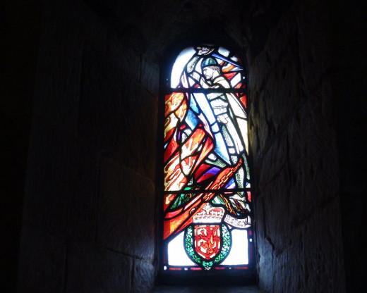 The Stain Glass of Sir William Wallace adorning the wall at St. Margaret's Chapel.