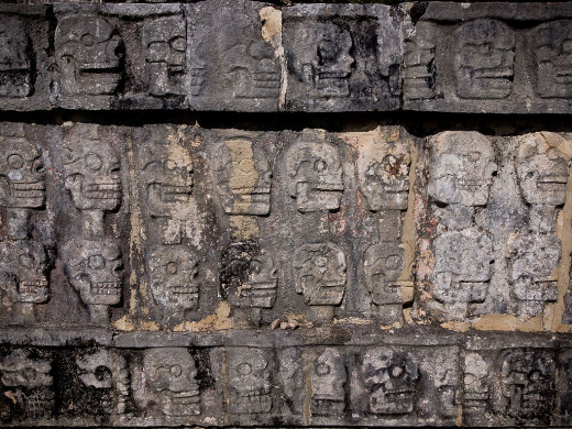 These carvings of human skulls mounted on poles completely surround the Tzompantli (Skull Platform) in the Great North Platform region at Chichen Itza